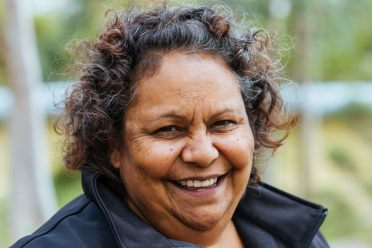 A smiling aboriginal woman
